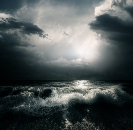 bigstock-dark-storm-clouds-and-huge-wav-20385731