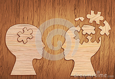 human-head-silhouette-mental-health-symbol-puzzle-jigsaw-piece-cut-out-wooden-background-69417191